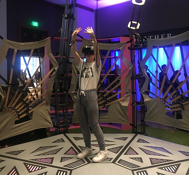 Our writer trying out the Meow Wolf VR