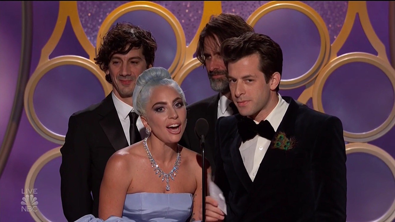 "Lady Gaga and Mark Ronson accepting the Best Song award for ""Shallow"" from 'A Star is Born.'"