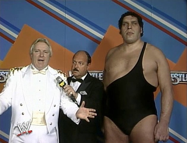 Mean Gene in-between Bobby 'The Brain' Heenan and Andre The Giant
