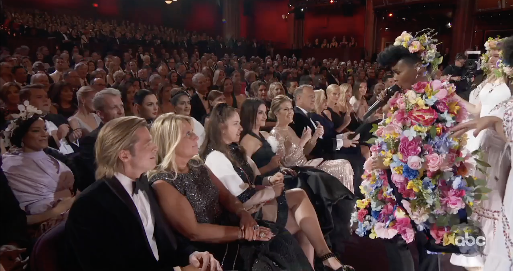 Janelle Monae, decked out in Midsommar garb, serenading Brad Pitt in the Oscars opening number.