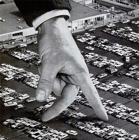 giant hand with cars