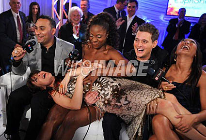 APRIL 06: Russell Peters, Jully Black, Feist, and Michael Buble are interviewed by E Talk host Tanya Kim in the E Talk Lounge at the 2008 Juno Awards April 6, 2008 at the Pengrowth Saddledome in Calgary, Canada